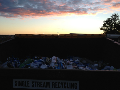 Volunteers filled a single stream recycling dumpster with recyclables collected during tailgating