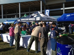 OEP's Fanfest Table, run by Sustainability Coordinators Corinne and Dave, and EcoHouse Program Coordinator Brigid Belko