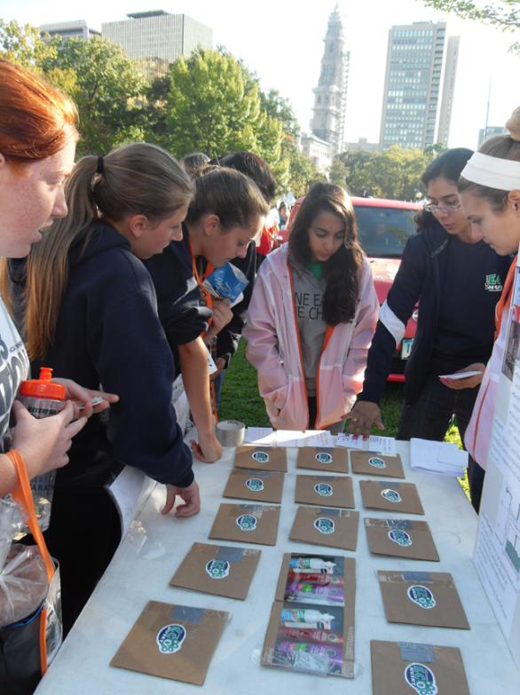 People stopped by to play a recycling themed memory game and answer sustainability trivia
