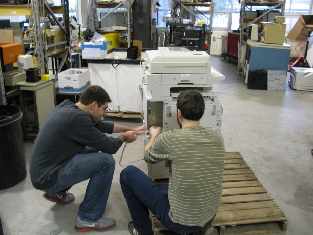 Surplus Student Employees preparing a copier for recycling